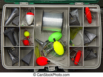 Tackle Box Top View - Surf fishing tackle box filled with...
