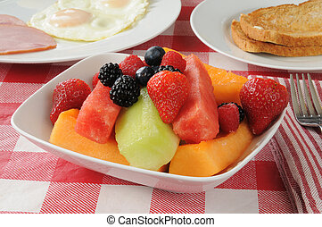 Fruit salad breakfast - A bowl of fruit salad with melon...