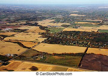 Aerial Farmland - An aerial view of prairie farmland at...