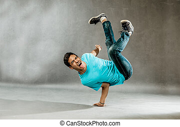 Extreme Dance - photo of a dancer who is performing extreme...