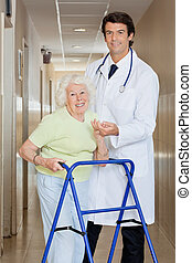 Doctor Helping An Old Woman With Her Walker - Young happy...