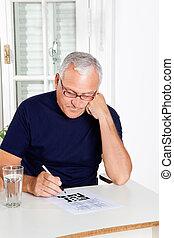 Man Playing Leisure Games - Senior man playing leisure games...