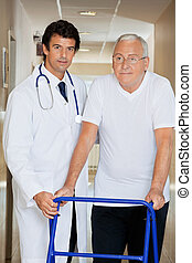 Doctor Helping An Old Man With His Walker - Young handsome...