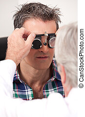 Eye Exam with Measuring Spectacles - Optometrist using...
