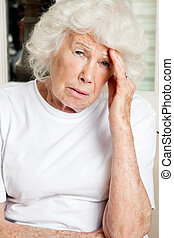 Woman With Headache - Portrait of a senior woman suffering...