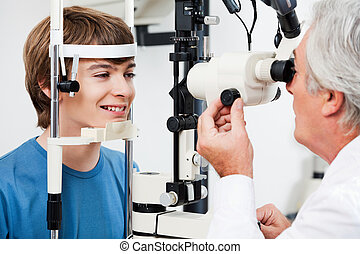 Visual Field Test For Glaucoma - Smiling boy getting visual...
