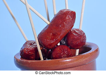 spanish chorizos - some red fried spanish chorizos served as...
