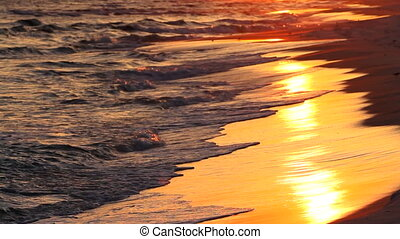Surf At Sunset - Surf of the Gulf of Mexico roll up in waves...