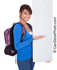 Beautiful student girl presenting empty banner Isolated on...