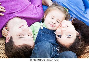 Family having fun outdoors - Happy family having fun...