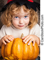 Beautiful child holding a pumpkin - Beautiful smiling child...