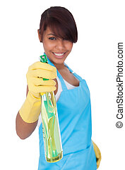 Cheerful young lady spraying cleaner liquid Isolated on...