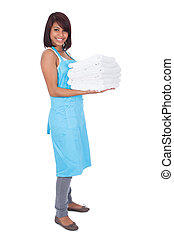 Smiling maid woman with towels Isolated on white