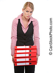 Tired woman with stack of folders