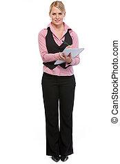 Woman employee writing in notepad