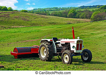 A white tractor in the fields in Springtime