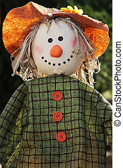 Scarecrow in the garden - Closeup of a scarecrow with...
