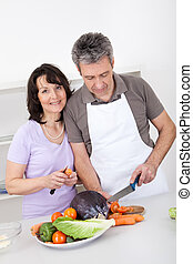 Senior couple cooking lunch at home Isolated on white