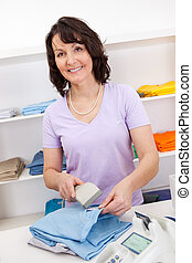 Sales person in the shop - Portrait of cheerful sales person...