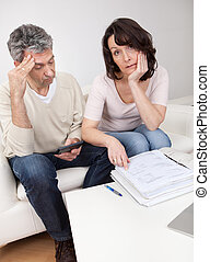 Mature couple in financial trouble