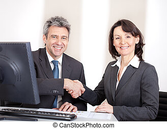 Business people in the office at the meeting - Two confident...
