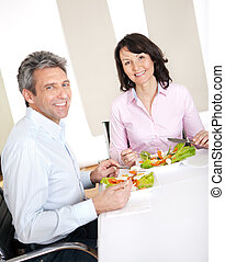 Mature couple having lunch at home - Mature couple having...