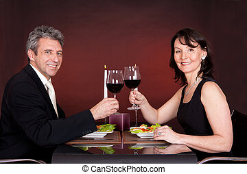 Couple at romantic dinner in restaurant - Mature couple...