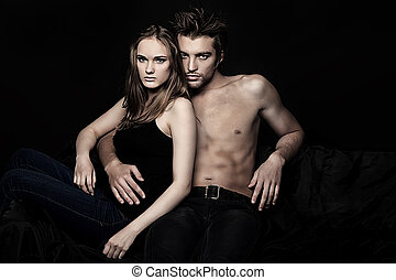 couple sofa - Shot of a passionate young people in love