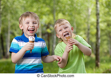 young children eating a tasty ice cream outdoor