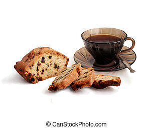 Cup of coffee and cake with raisins.