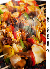 BBQ barbecuing skewers kebab - Bar-B-Q or BBQ with kebab...