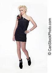 Beautiful young woman standing wearing black dress