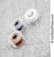 Threads on a fabric.