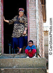 Family - Grand mother and her son together on the porch of...