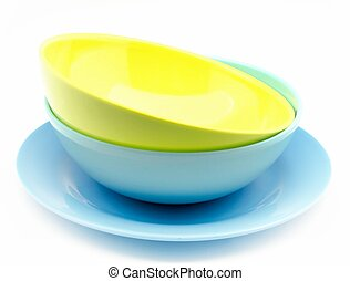 Colored plastic dishes surrounded by white background