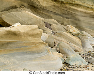 Sandstone sediment smoothed and rounded by water