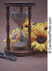 Hourglass, Flowers, & Skeleton Key - Hourglass next to black...