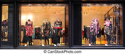 Boutique with dressed mannequins - Boutique window with...
