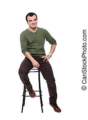 casual young adult on a chair, isolated on white