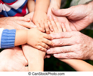 Join hands - Family holding hands together closeup