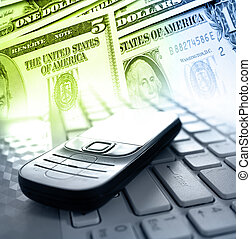 Internet banking - Cellphone, laptop computer and banknotes