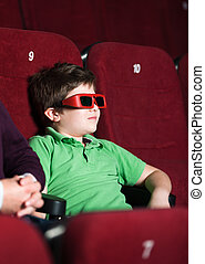 A boy in 3D movie theater