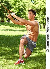 Handsome man doing exercises - Handsome man doing outdoor...