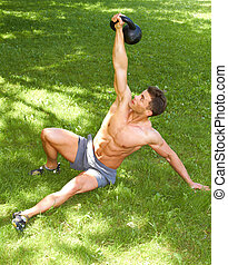 Working with kettlebell at outdoor - Fitness Man Working...