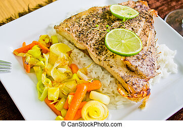 Portion of fish with rice and vegetables