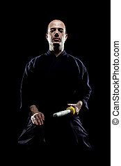 Kendo fighter - portrait of a kendo fighter with shinai,...