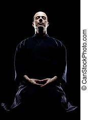 Kendo fighter - portrait of a kendo fighter meditating,...