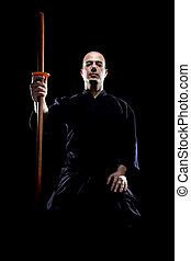 Kendo fighter - portrait of a kendo fighter with bokken,...