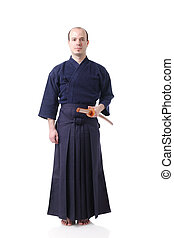 Kendo fighter - portrait of a kendo fighter with bokken
