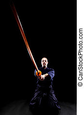 Kendo fighter with Bokken - portrait of a Kendo fighter with...
